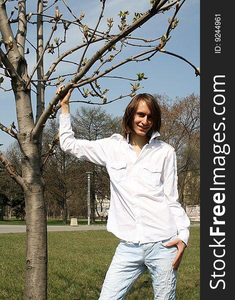 Man standing near a tree