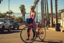 Free Woman Standing Holding Pink Mountain Bike During Daytime Royalty Free Stock Image - 92427876