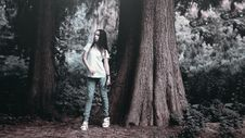 Free Woman In T Shirt Posing Beside Rough Bark Tall Tree In Grayscale Photography Royalty Free Stock Photography - 92427977