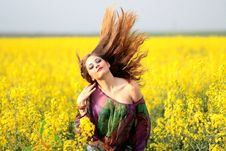 Free Portrait Of Young Woman With Yellow Flowers In Field Stock Image - 92428491