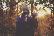 Free Woman Holding Camcorder In Forest Shooting Sunset Stock Image - 92429851