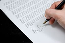 Free Person Signing Agreement Stock Image - 92460581