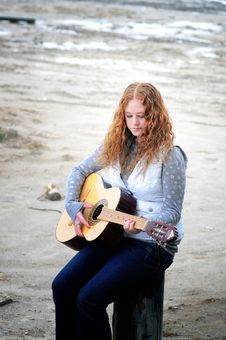 Free Girl By The Sea With Her Guitar Stock Photo - 9255450
