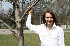 Happy Man Standing Near A Tree Stock Image