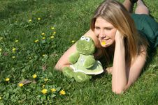 Free Funny Girl With A Toy Frog Royalty Free Stock Photography - 9255957