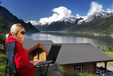 Free Woman Working On The Lake Shore Royalty Free Stock Images - 9257769