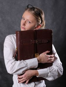 Free Woman Hugging A Briefcase Royalty Free Stock Images - 9257839