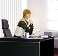 Free Businesswoman In Her Office Royalty Free Stock Image - 9259496
