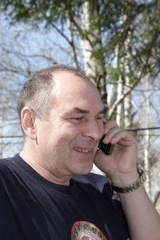 Speaking Man In Park Royalty Free Stock Photo