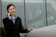 Free Asian Businesswoman On Cell Phne Stock Photos - 9261833