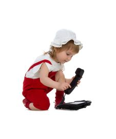 Free Little Girl Speaks On The Phone Stock Images - 9262814