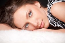 Free Portrait Of Brown-haired Girl Laying On White Fell Royalty Free Stock Images - 9263649