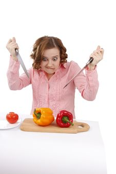 Woman Wants To Eat Sweet Peppers. Stock Photo