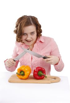 Free Housewife With Sweet Peppers And Knifes. Stock Images - 9263674