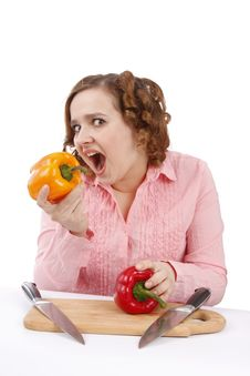 Girl Is Eating The Pepper. Stock Image