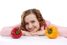 Young Woman With Sweet Peppers. Stock Photo