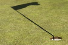 Golf Field Showing The Hole And The Flag Shadow Royalty Free Stock Photos