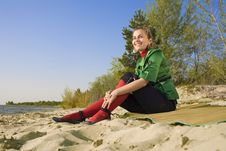 Free Girl Sitting On Sea Coast Stock Images - 9268054