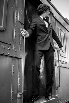 Free Man On Doorway Of Train Stock Photography - 92653902