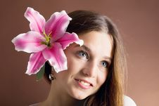 Free Young Woman Posing With A Pink Lily Stock Photo - 9270260