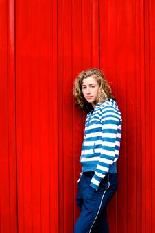 Free Teenage Girl Against Red Wall Royalty Free Stock Image - 9272216