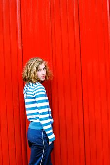 Free Pretty Teenage Girl Against Red Wall Stock Photos - 9272233