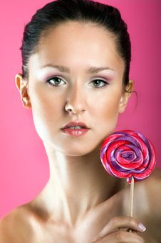 Free Smiling Woman With A Lollipop Royalty Free Stock Image - 9272946