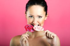 Free Smiling Woman With A Lollipop Royalty Free Stock Photo - 9272995