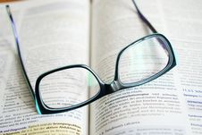 Free Reading Glasses On A Book  Stock Images - 92710674