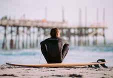 Free Man Sitting On Surfboard Stock Image - 92753231