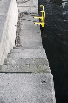 Pier With A Yellow Ladder Stock Image
