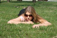 Free Girl Lying On Grass Stock Photo - 9283480