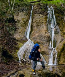 Waterfall And Boy Is Hiker Royalty Free Stock Images