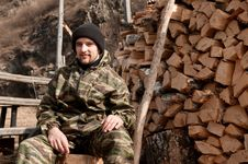 Free A Man Near Pile Of Firewood Royalty Free Stock Photo - 9287825