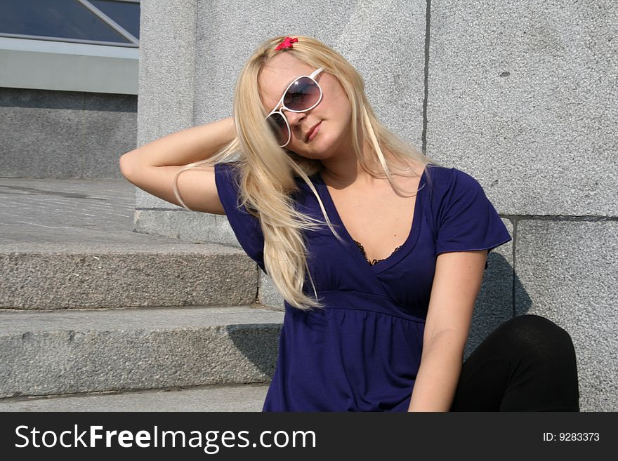 Girl sitting on stone stairs