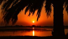 Free Orange Sunset Over Tranquil Lake Royalty Free Stock Photo - 92801555