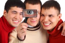 Free Three Friends Look Through Magnifier Royalty Free Stock Image - 9290506