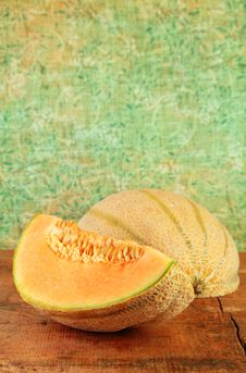 Sliced Cantaloupe On A Wooden Table Stock Image
