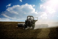 Free The Tractor Ploughs A Field Stock Images - 9294664