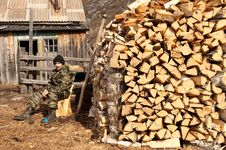 Free A Man Near Pile Of Firewood Stock Photo - 9297710