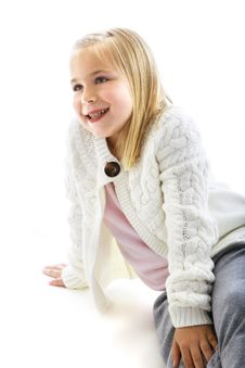Cute Little Girl Wearing A White Sweater Stock Image