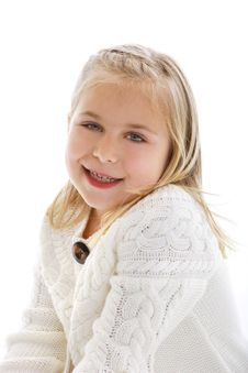 Cute Little Girl Wearing A White Sweater Royalty Free Stock Images