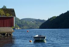 Free Dinghy And Old Boathouse Royalty Free Stock Photo - 935685