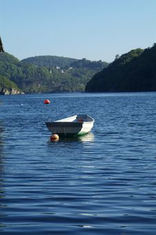Dinghy And Old Boathouse Royalty Free Stock Images