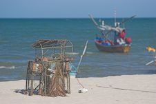 Lobster Pot And Fishing Boat Royalty Free Stock Images
