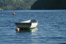 Dinghy On The Water Royalty Free Stock Photos
