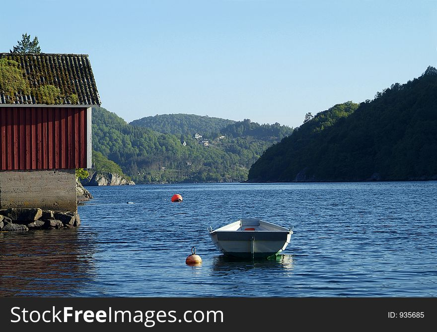 Dinghy and old boathouse