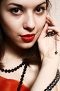 Free Beads And Red Lips. Royalty Free Stock Photography - 9304617