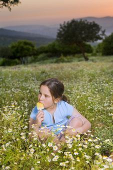 Young Girl Having A Popsicle Royalty Free Stock Images