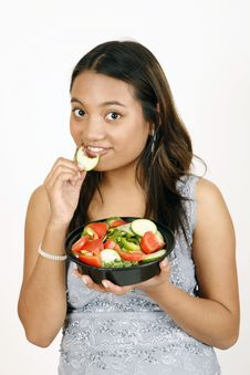 Free Girl Eating Salad Royalty Free Stock Photography - 9303197